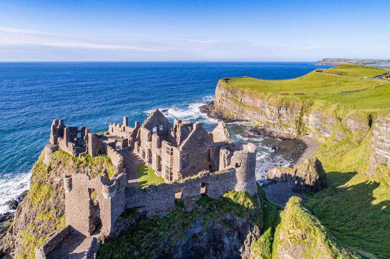 Ruins of medieval Dunluce Castle, cliffs, bays and peninsulas