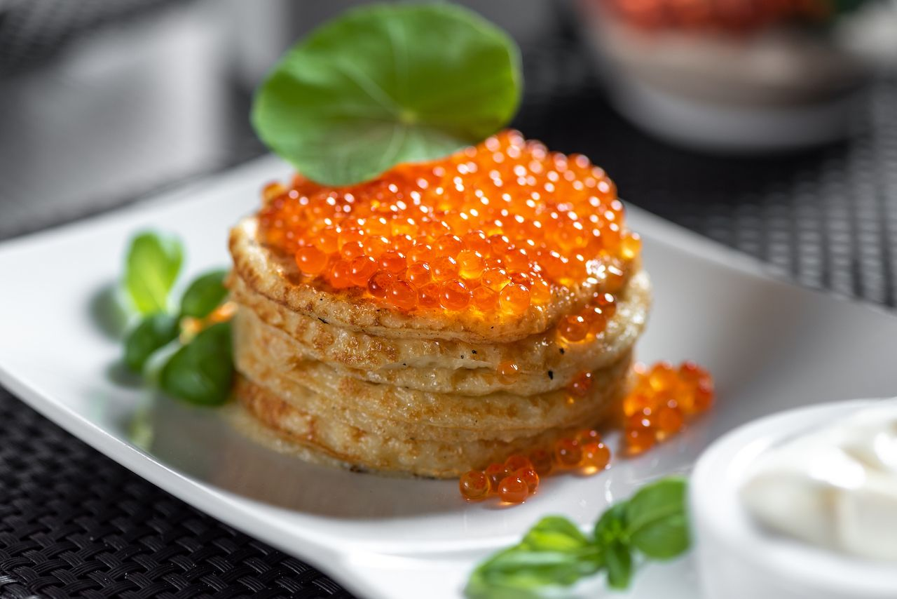 Russian style pancakes with caviar
