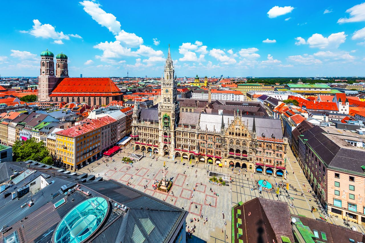 Scenic summer aerial view of the ancient medieval Gothic architecture City Hall building at the Market Square Marienplatz in Munich, Bavaria