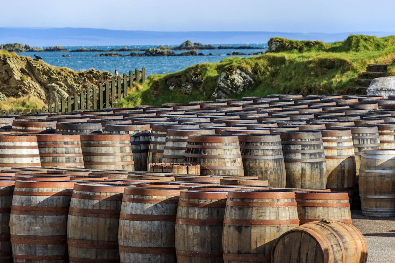 Scotch whiskey barrels lined up on the Island of Islay, Scotland