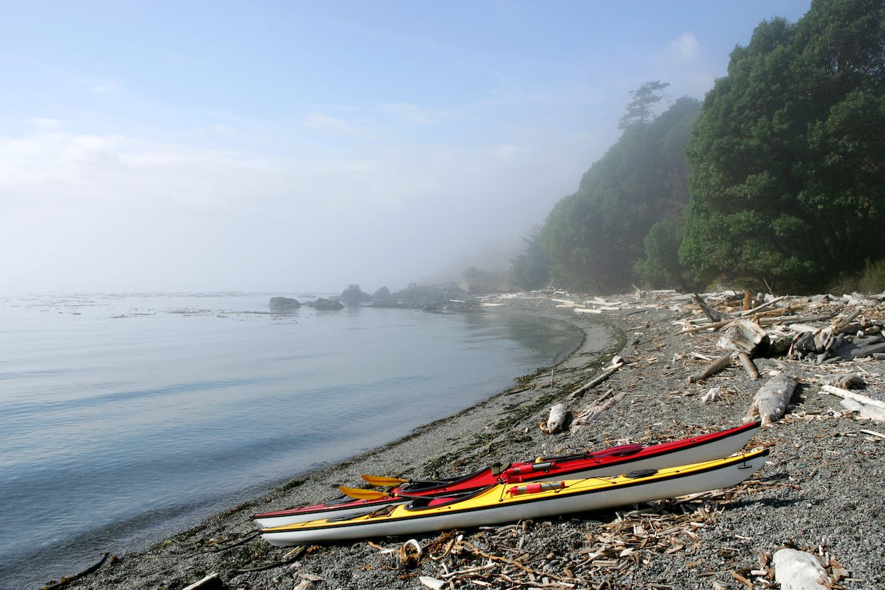 Sea kayaks on deserted ocean beach, San Juan Islands, Washington