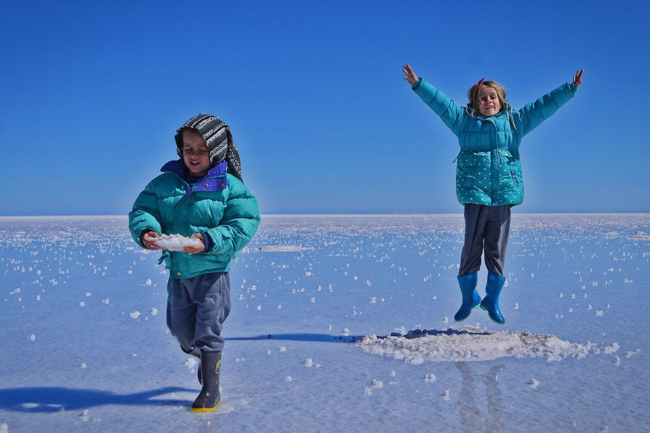 Two kids on salt flat in Bolivia