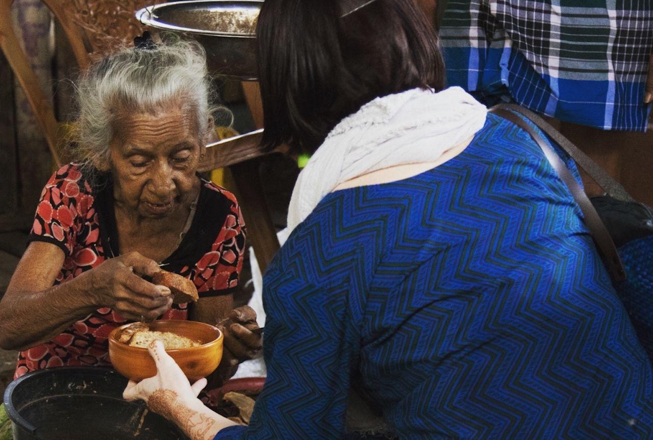 Two women baking together in Sri Lanka