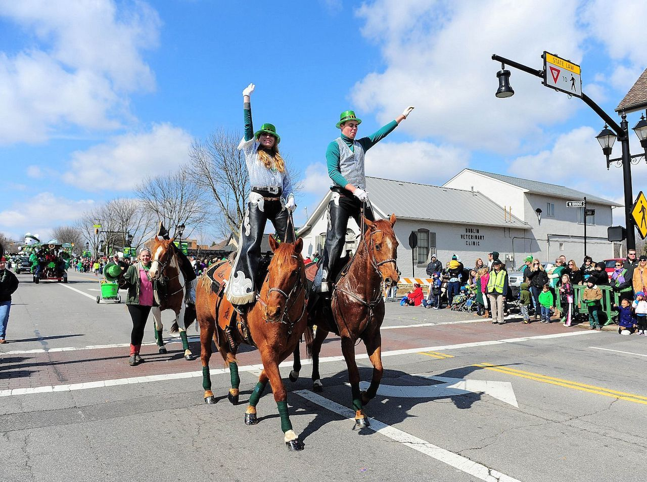 St Paddys Day paraders standing on horses