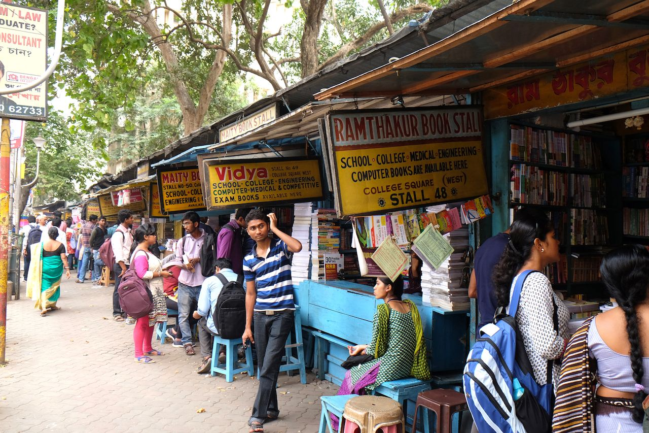 Students check out books at an old street side book stall at College Street Book Market in Kolkata, India