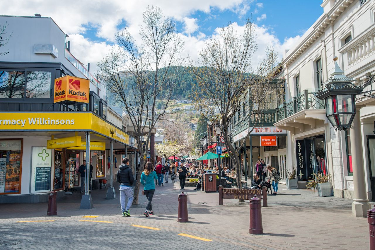 Tourist walking on the walking street of Queenstown mall, New Zealand