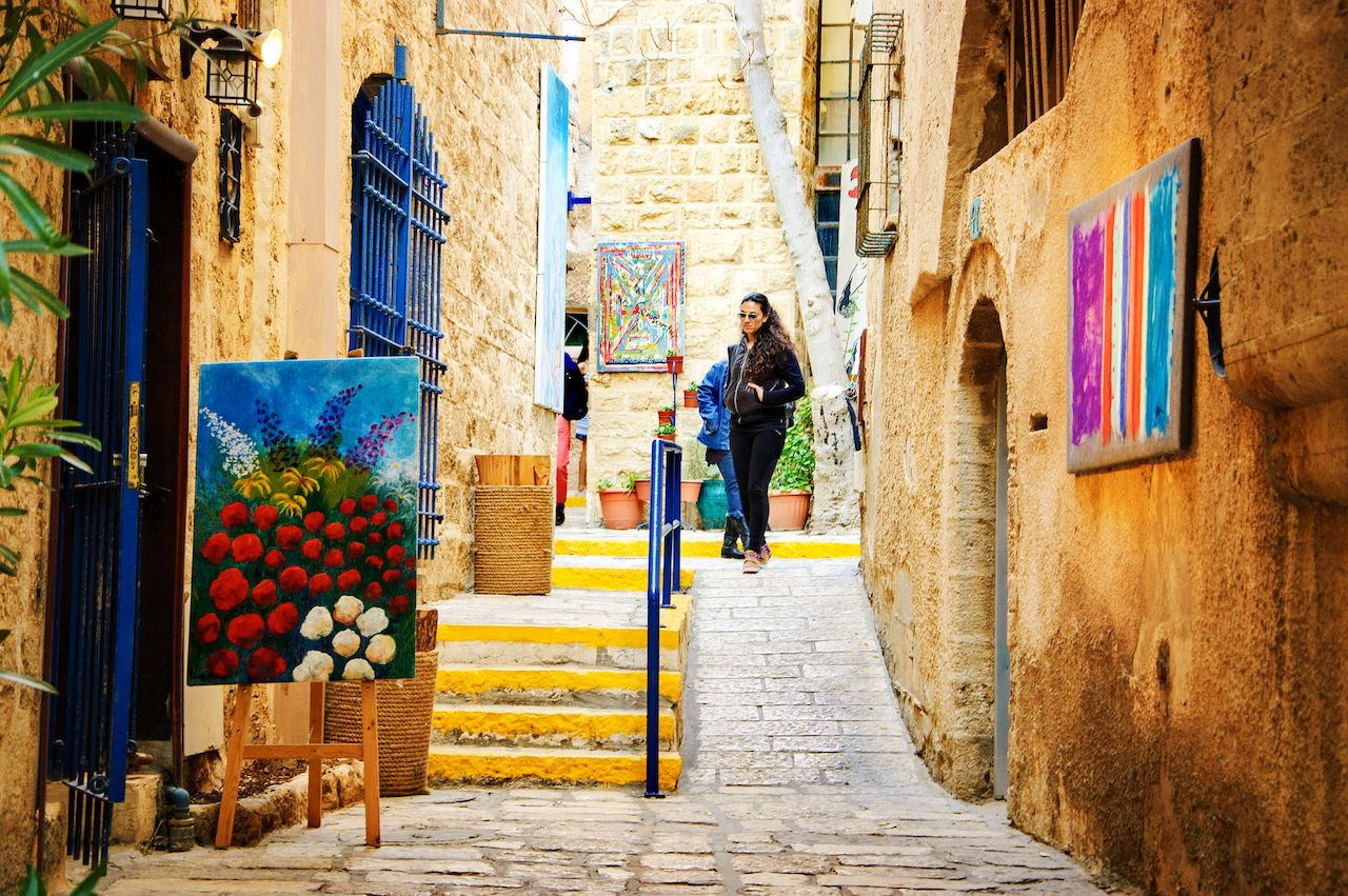 Tourists visiting unique art galleries found at narrow streets Old Jaffa, Tel Aviv, Israel