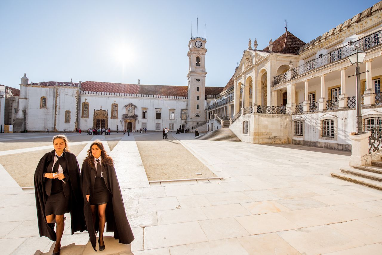 View on the courtyard of the oldest university with students in black uniform in Coimbra city in central Portugal