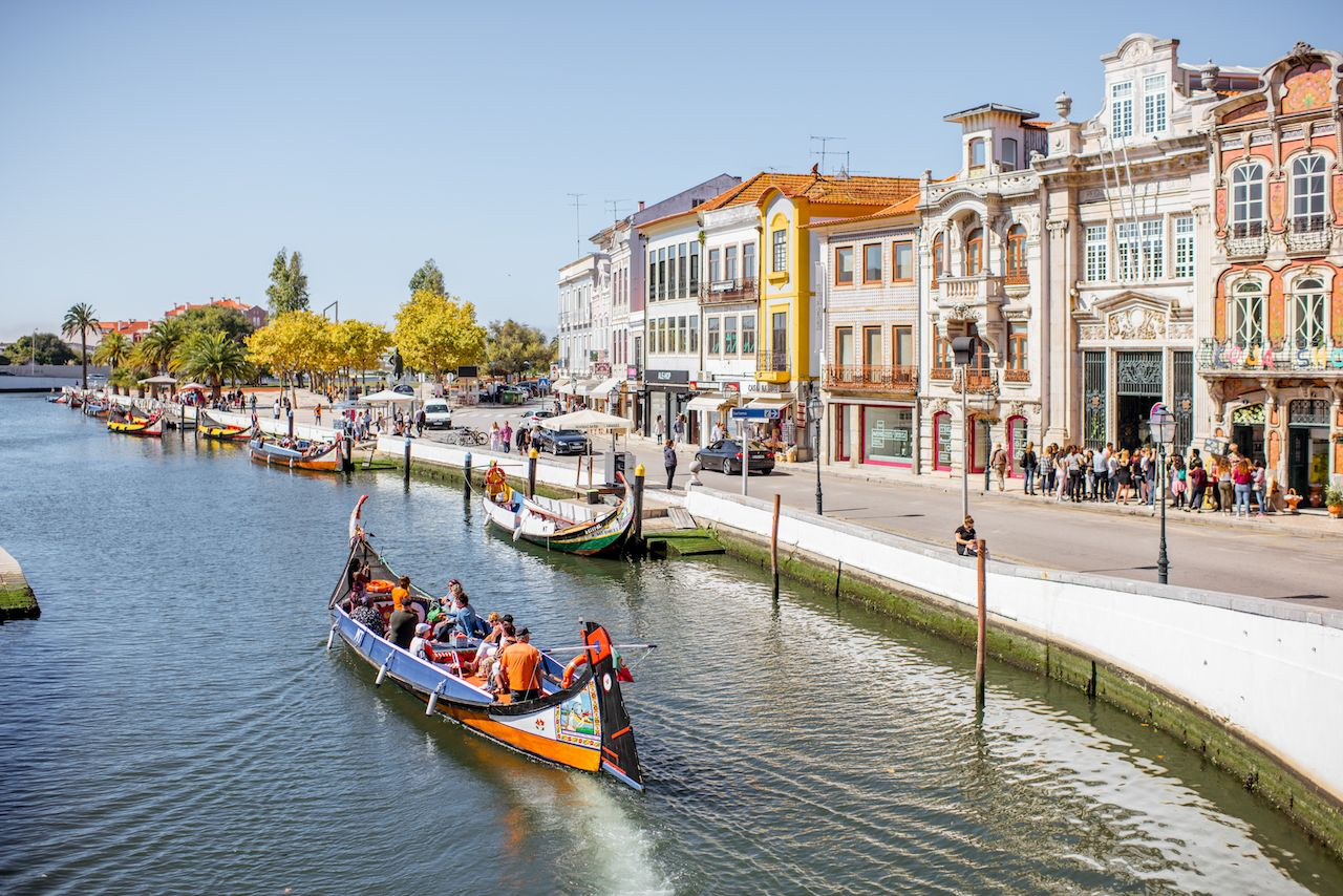 View on the water channel with boats and colorful old buildings in Aveiro city in Portugal
