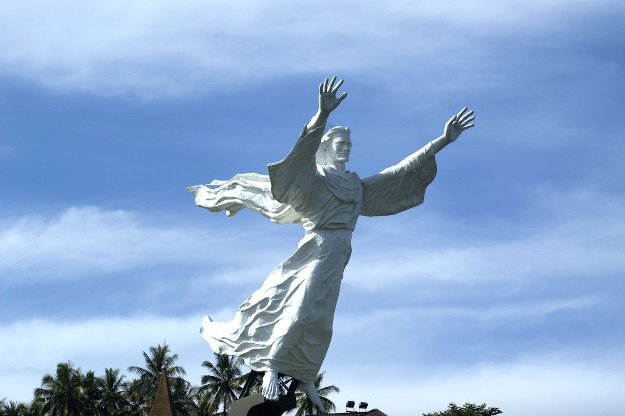 White Jesus Christ statue with arms outstretched