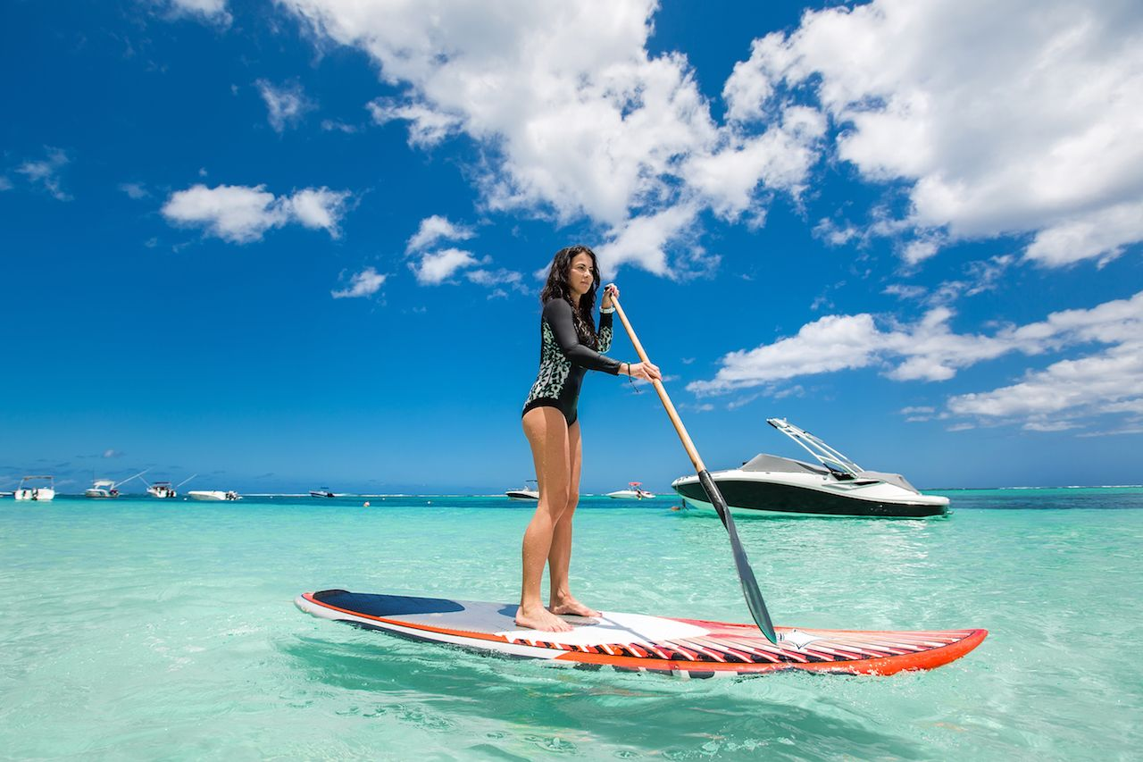Ms. SUPING in the tropics