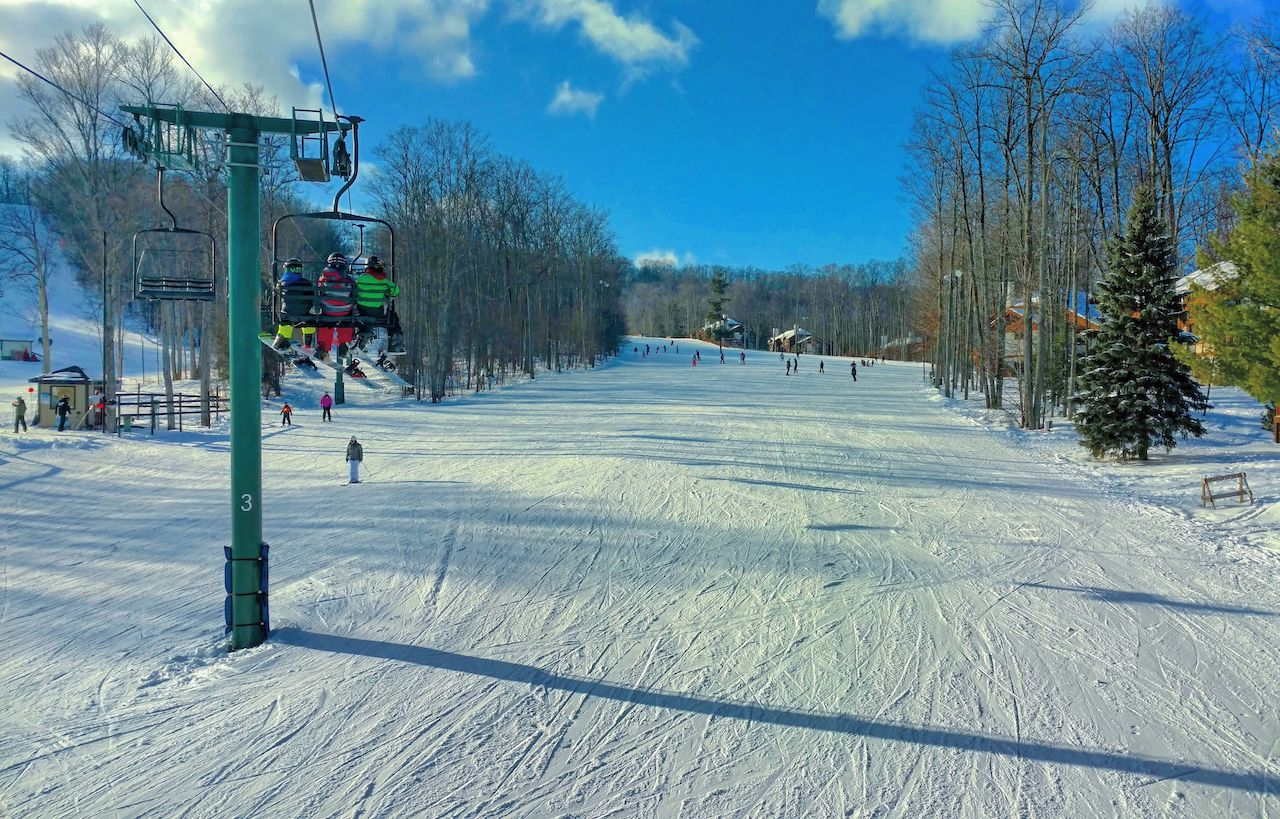 Skiers on the Boyneland Lift at Boyne Mountain in Northern Michigan