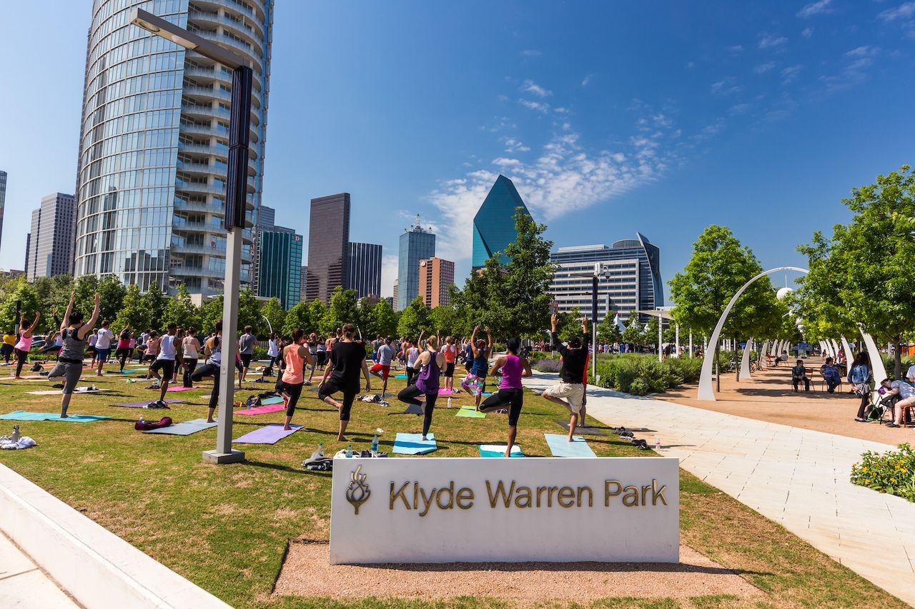people doing yoga in Klyde Warren Park in downtown Dallas
