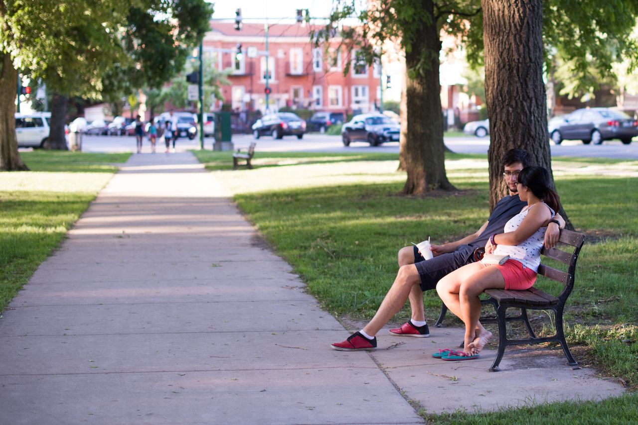 A young couple relaxes in Palmer Square Park in the Logan Square neighborhood