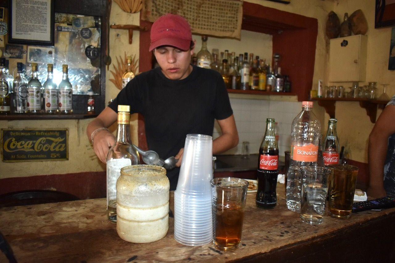 Bartender making a drink at La Capilla
