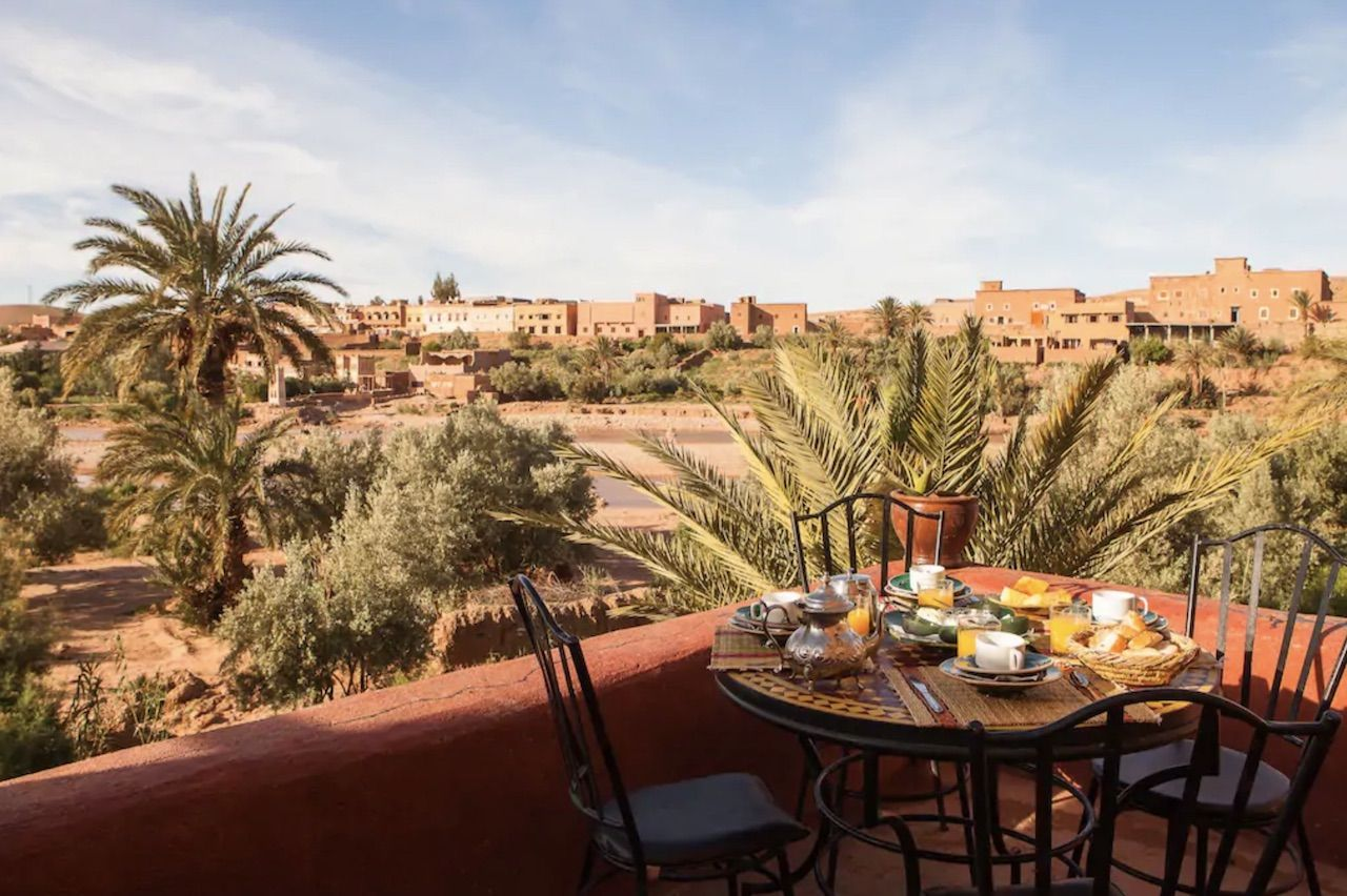 Breakfast table set outside with views over Morocco