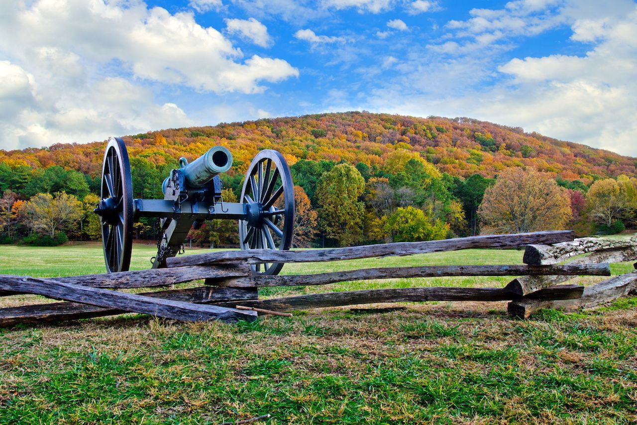 Civil War era cannon overlooks Kennesaw Mountain National Battlefield Park during fall