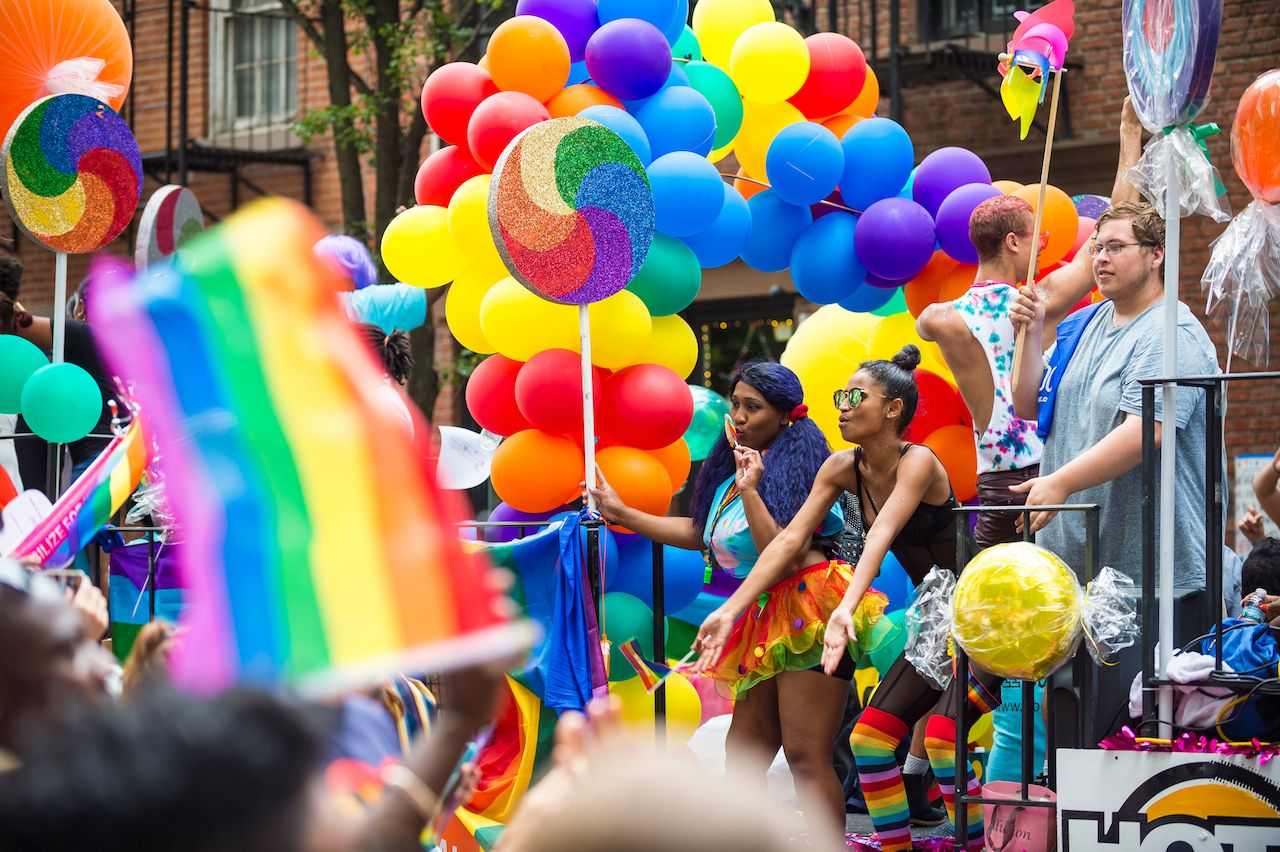 Colorful float at NYC Pride Parade as it passes through Greenwich Village