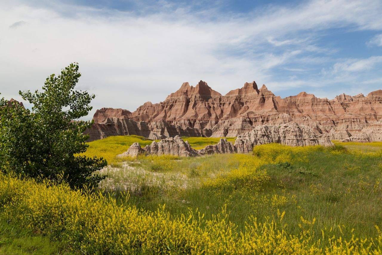 Dramatic mountain formations carved out by erosion showing layers of rocks in Badlands National Park
