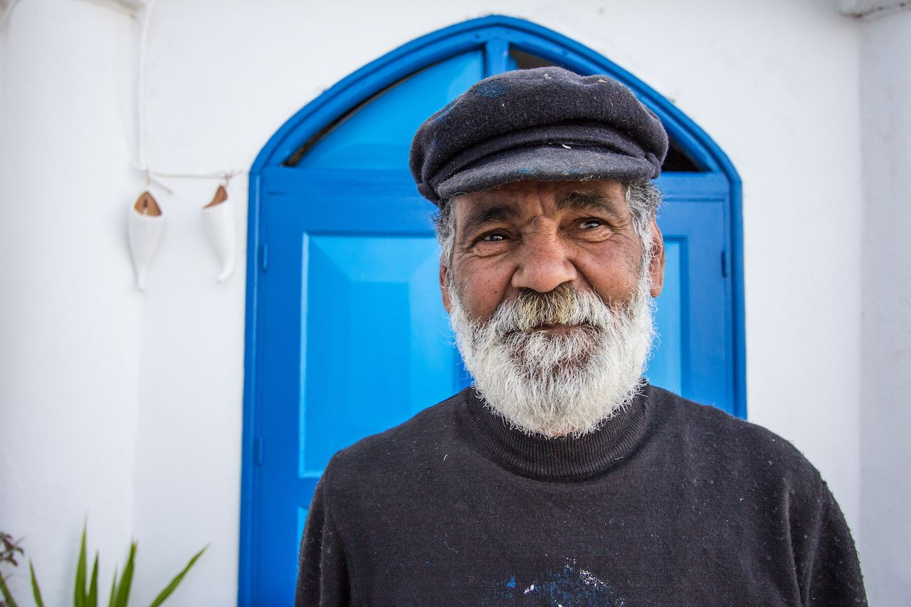 Gray bearded man posing in Sidi Bou Said
