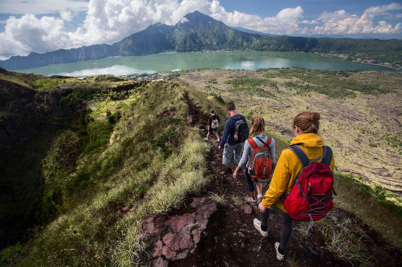 Group of hikers walking on the Caldera of Volcano of Batur, Bali