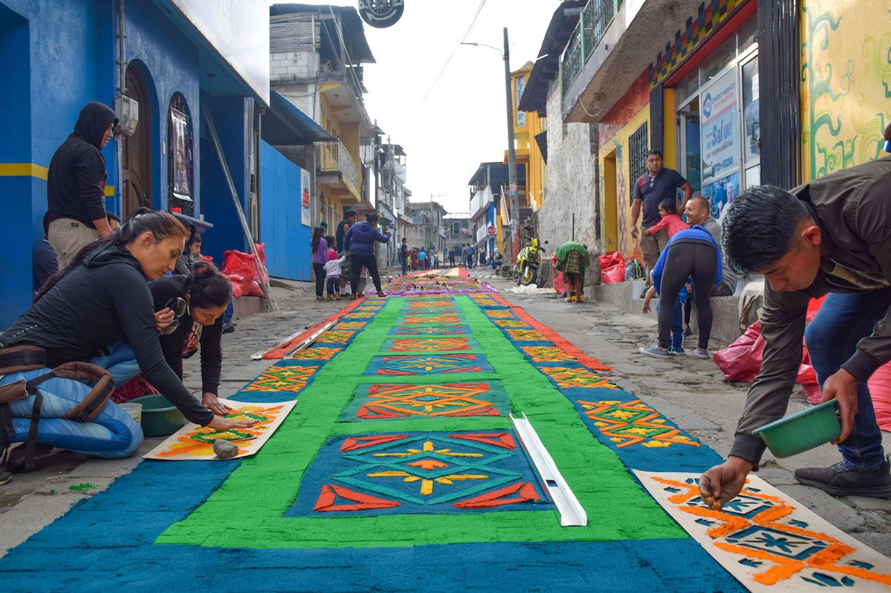 Making an alfombra in the streets of Guatemala
