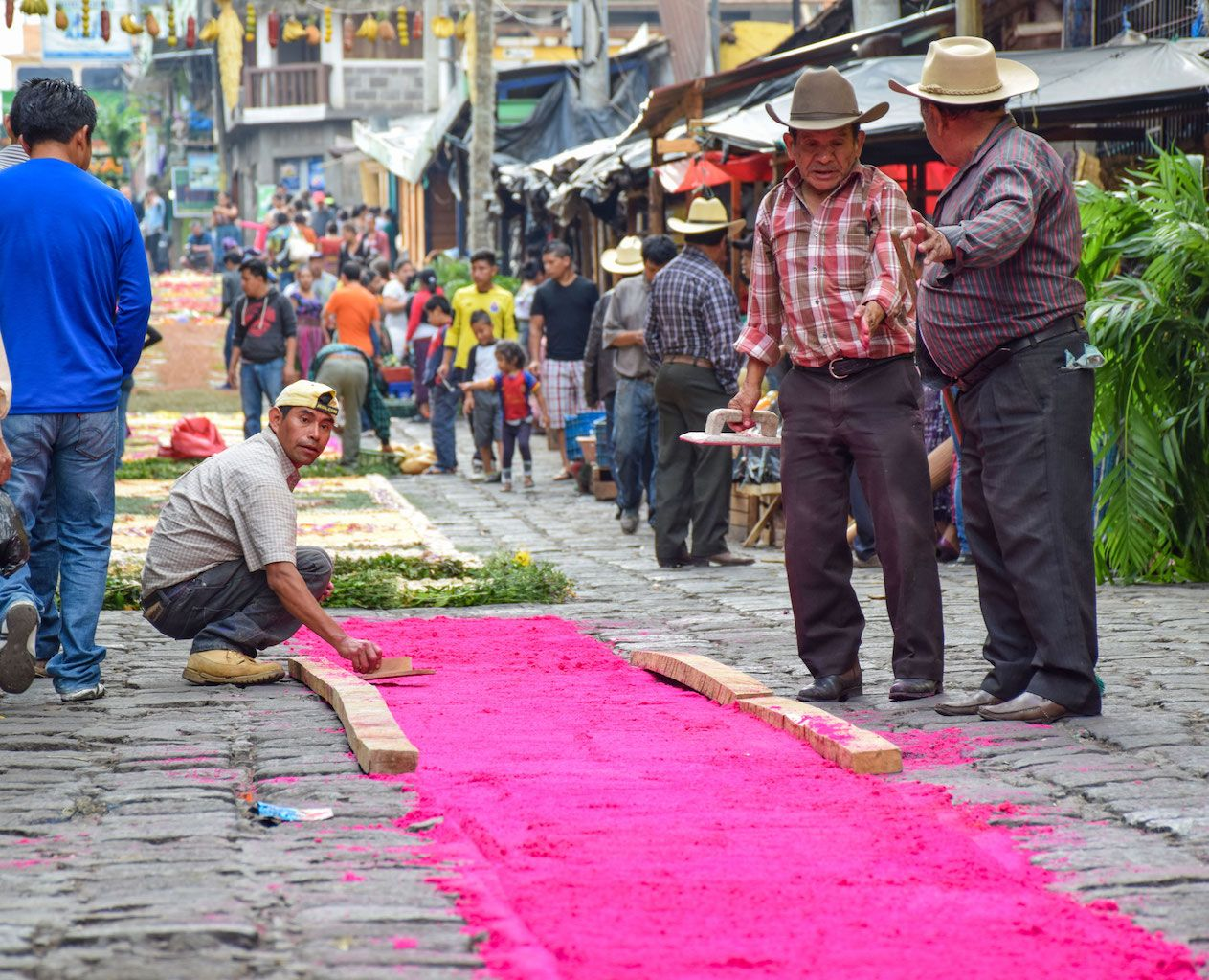 Men making an alfombra in Guatemala for Easter