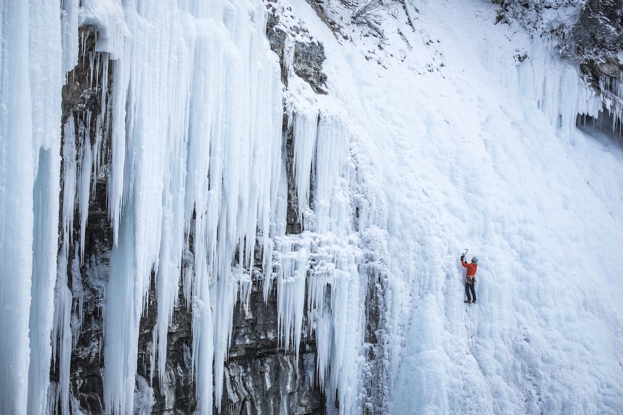 Person climbing in snow and ice in Banff