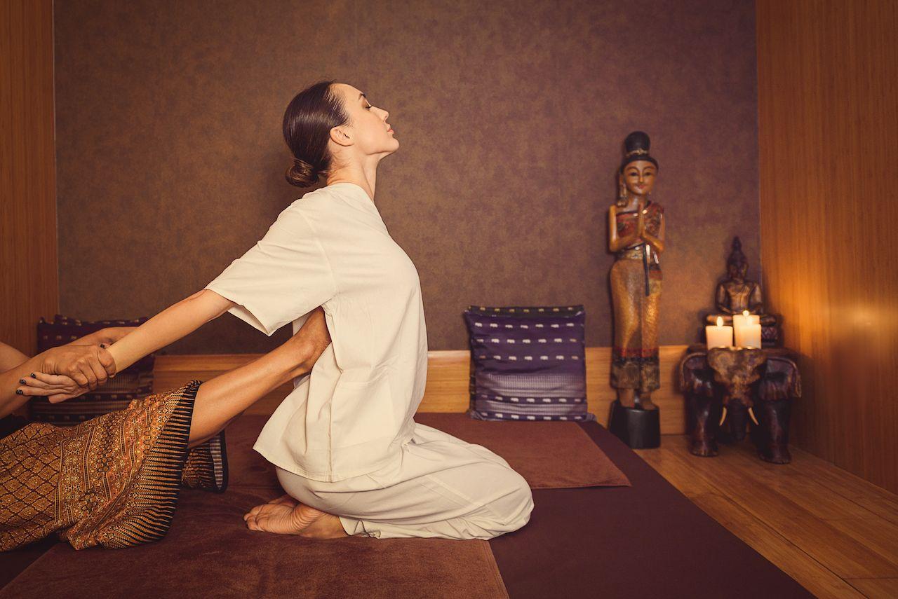 Serene girl enjoying thai massage