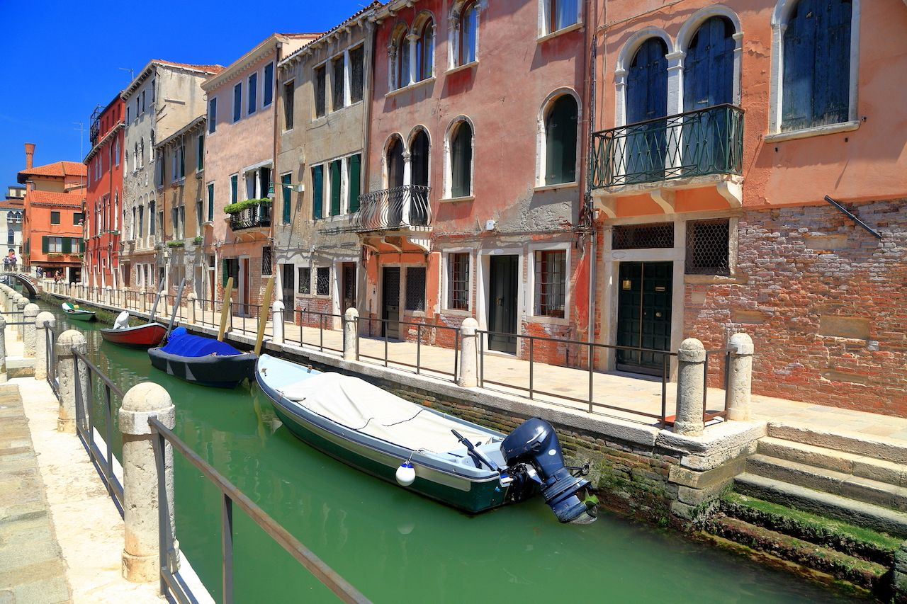 Small boats on a canal in Dorsoduro Quarter, Venice, Italy