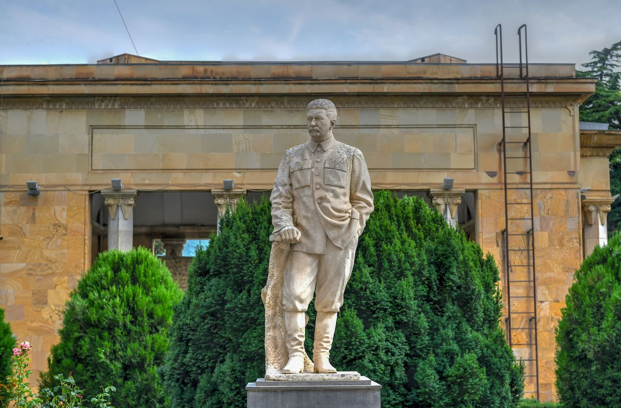 Statue of Joseph Stalin outside his house and museum In Gori, Georgia
