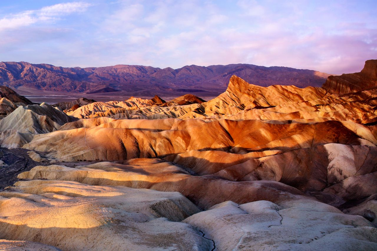 The Colorful Ridges Of Zabriskie Point At Sunrise