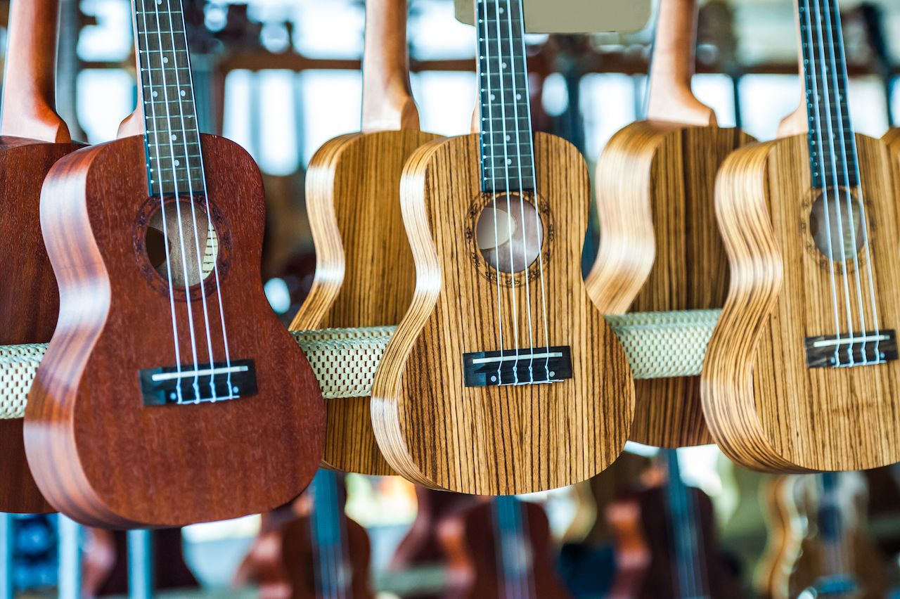 Ukuleles hanging up in a shop