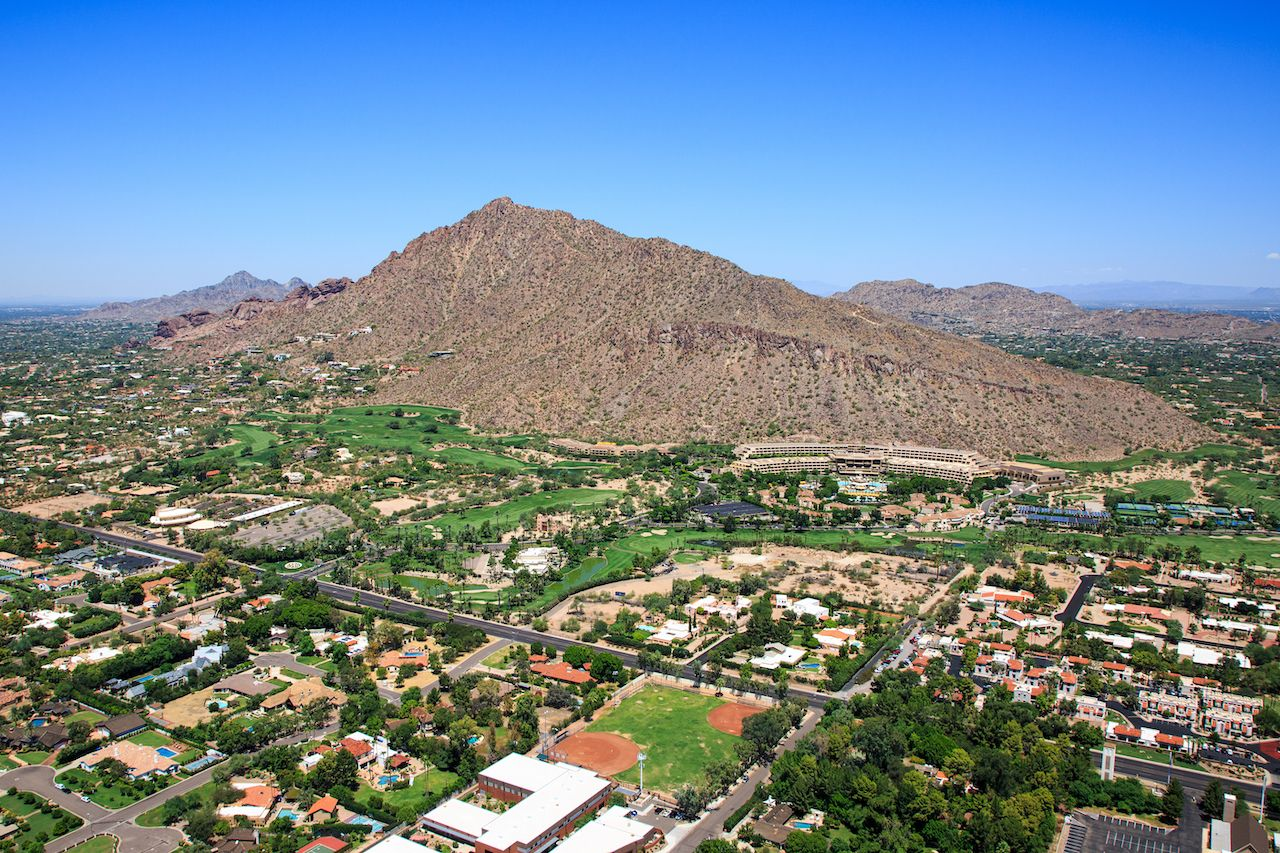 Aerial perspective of exclusive homes and golf course near Camelback Mountain in Phoenix, Arizona
