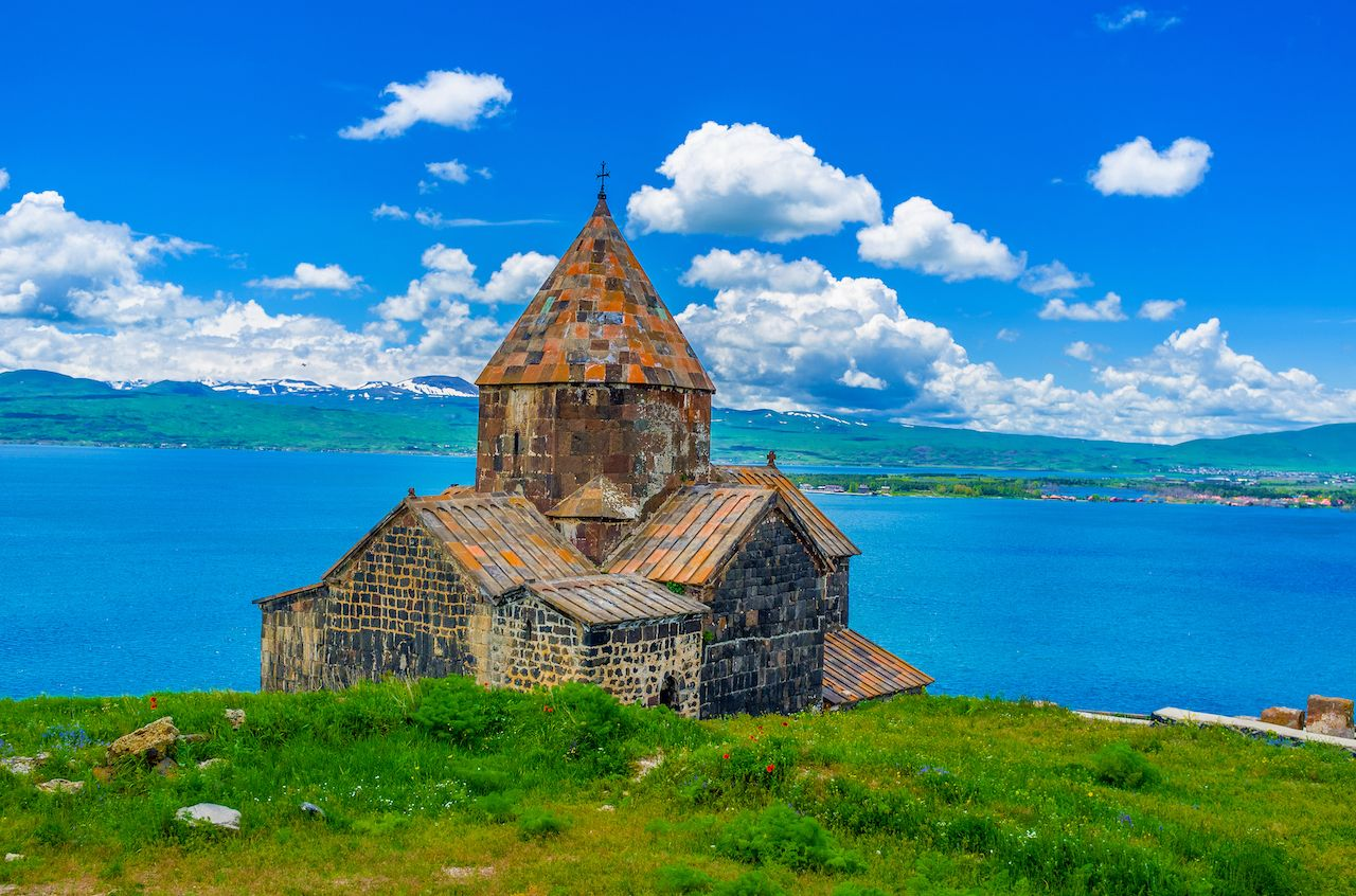 Church of Sevanavank Monastery with the Sevan Lake and snowy mountains on the background, Sevan, Armenia