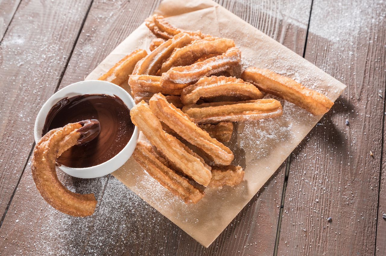 Churros with sugar and chocolate sauce