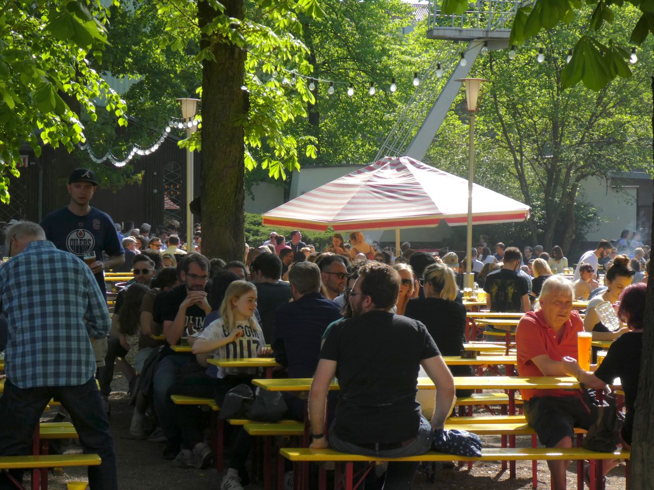Crowd of people chilling out outdoors on a terrace restaurant