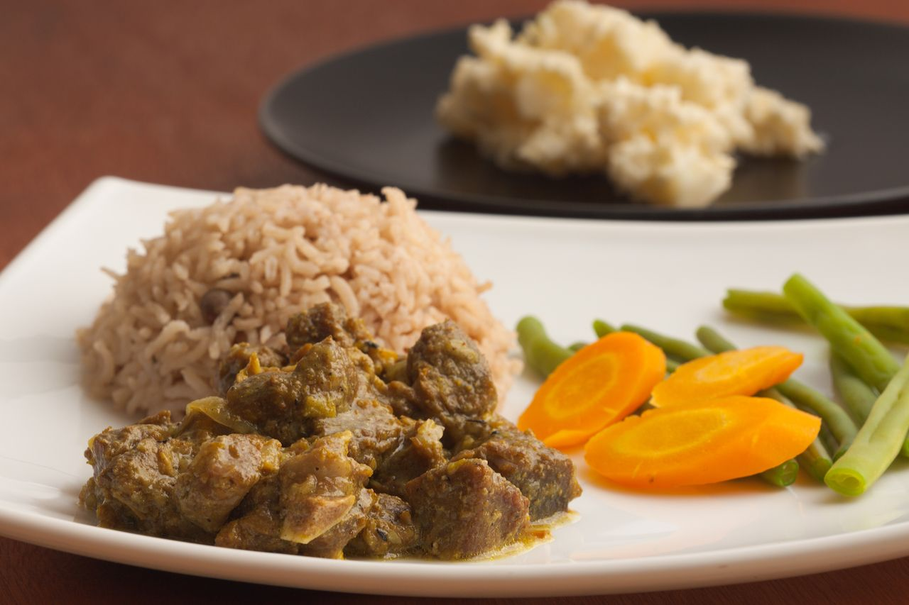 Curried goat with rice