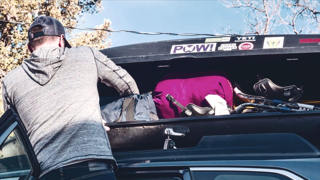 Dad packing a car for a trip with his family