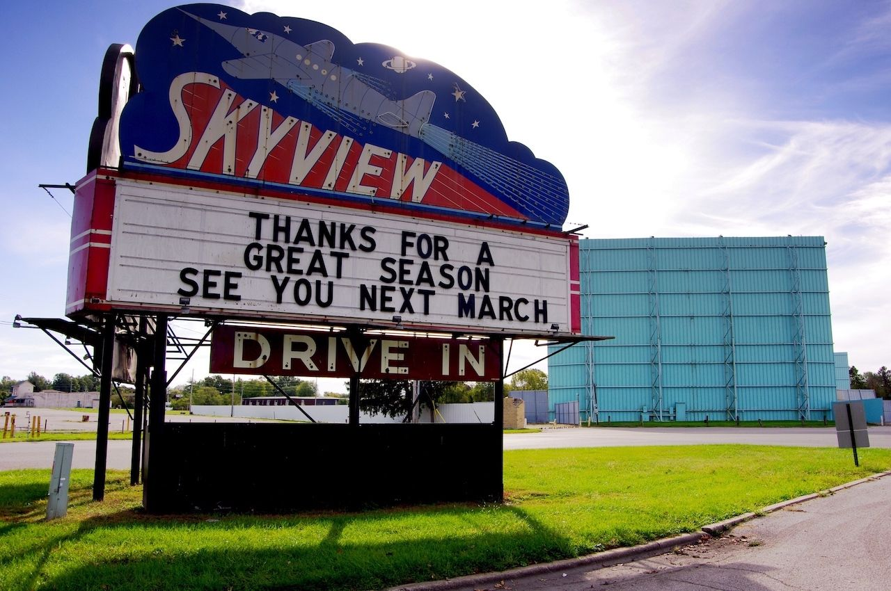 Drive in movie theater posts end of season sign on Marquee in Belleville, IL