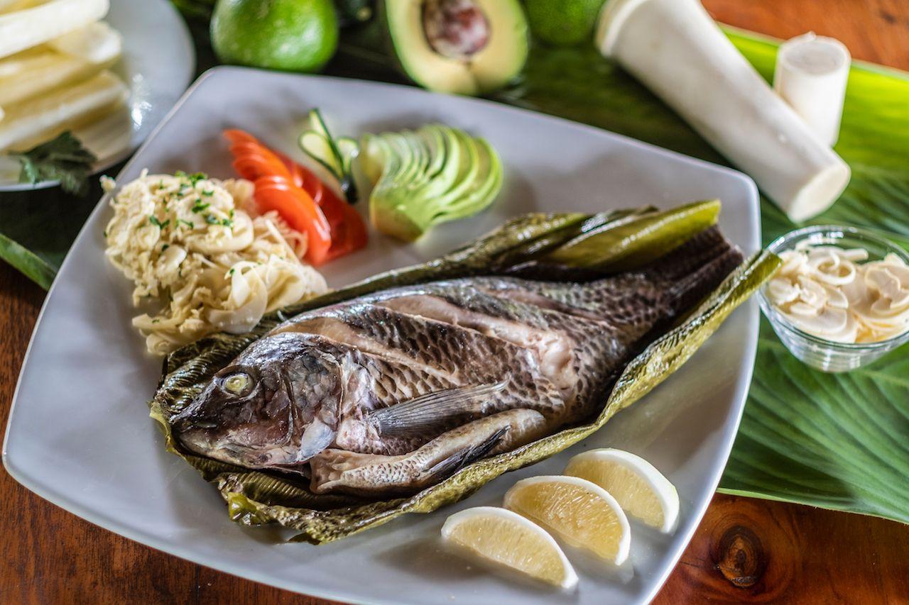 Ecuadorian Traditional Dish Maito de Pescado, fish wrapped in banana leaves