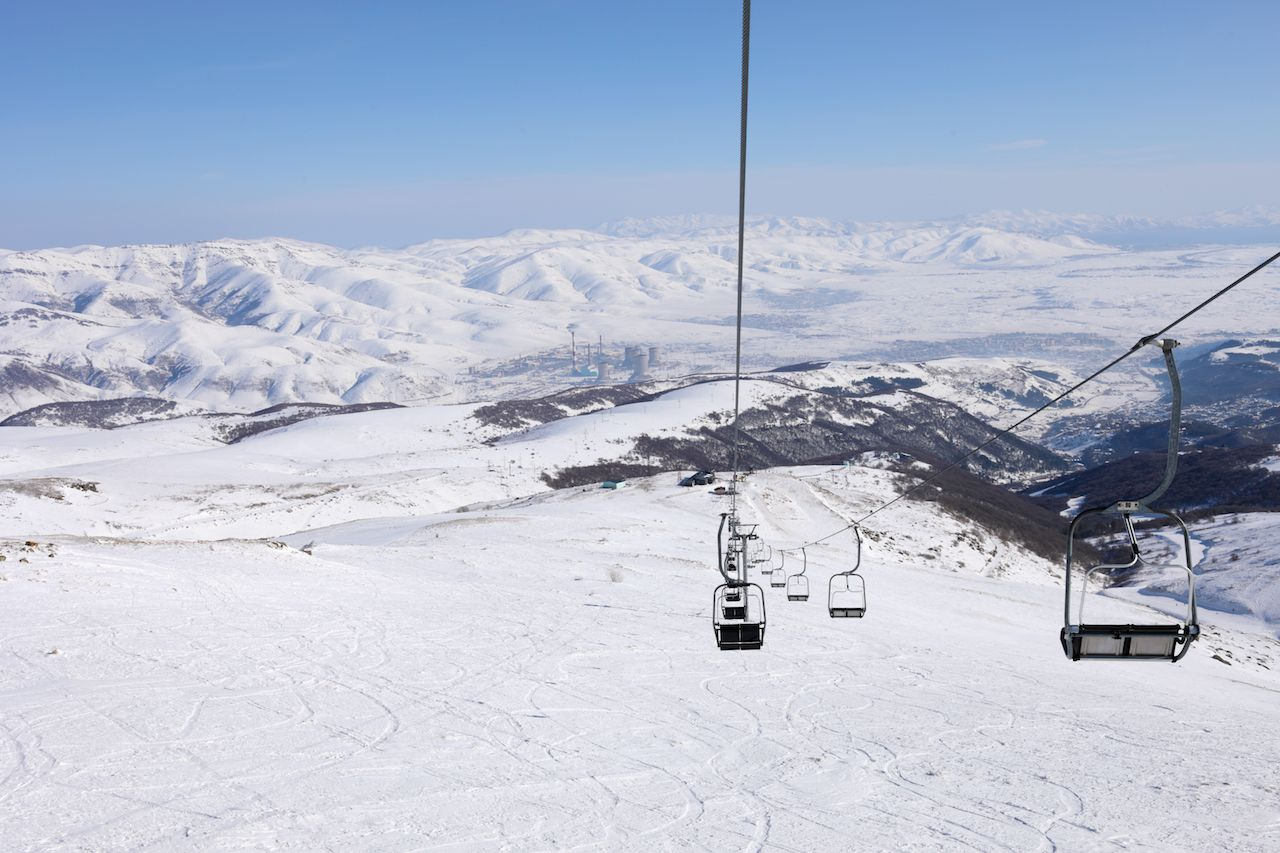 Empty cableway at winter day in Cahkadzor resort in mountains