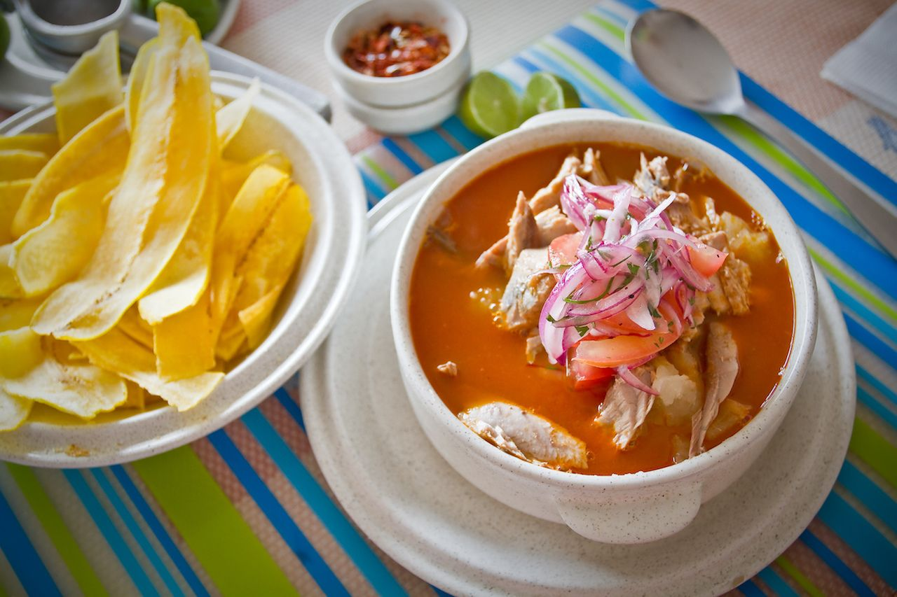 Encebollado, fish stew, served with banan chips and lemon