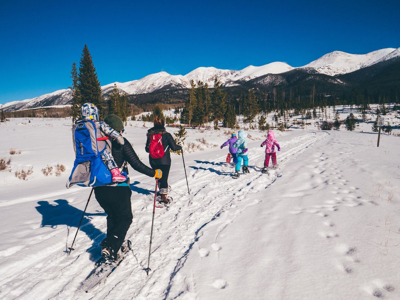 Family cross country skiing in the mountains