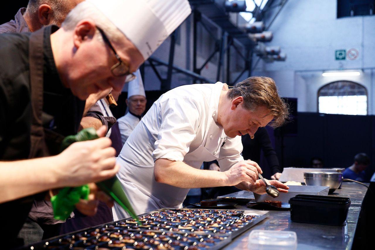 Famous Belgian chocolatier Pierre Marcolini prepares chocolate dessert in Salon du Chocolat