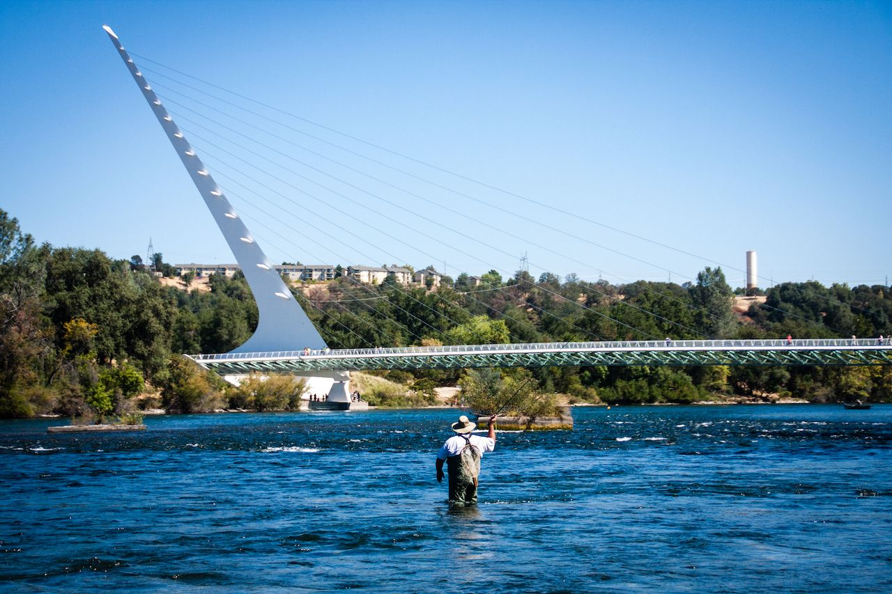 Fisherman-wading-in-the-water-in-Redding