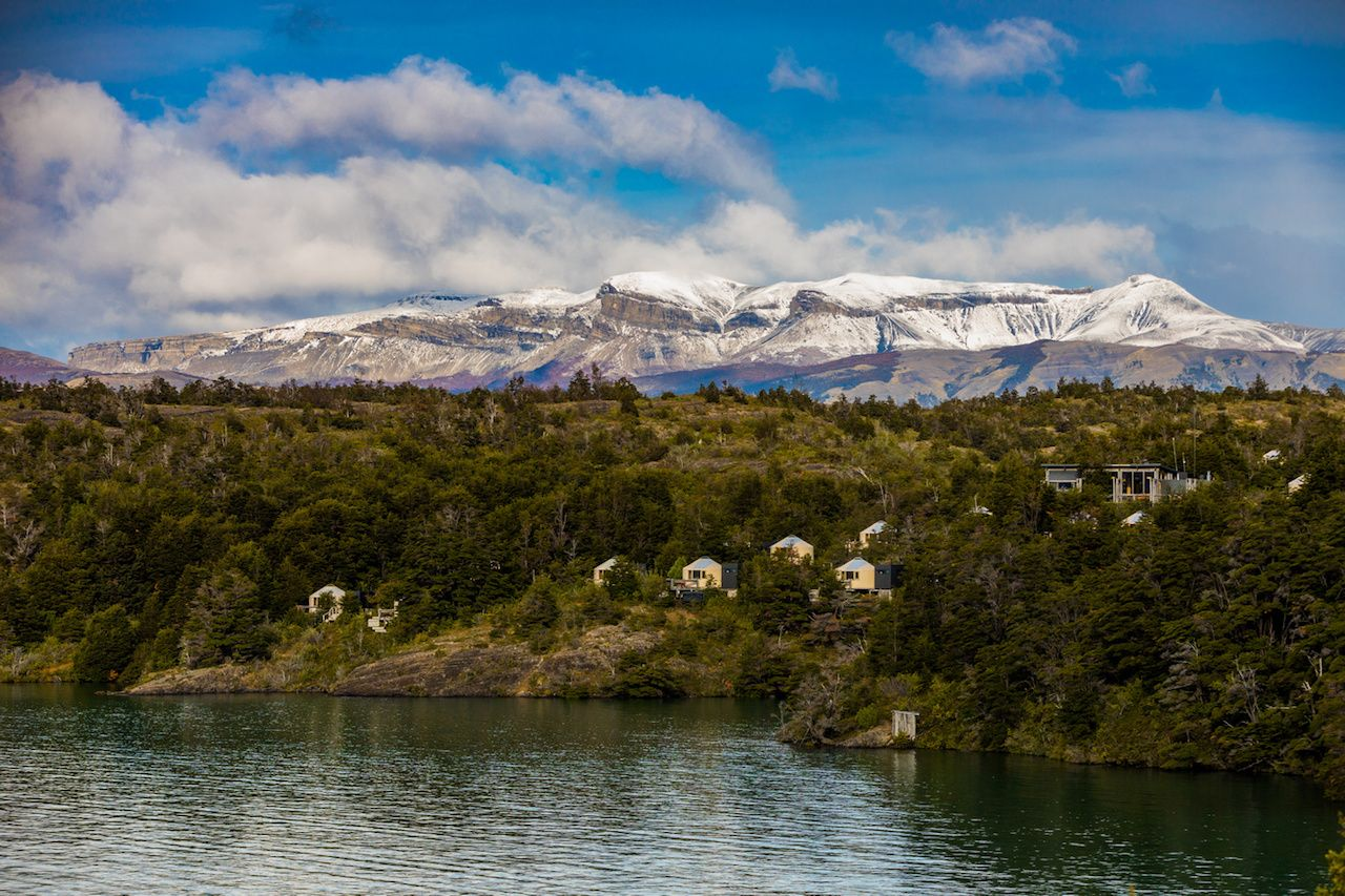 Glamping setup in Patagonia between mountains and water