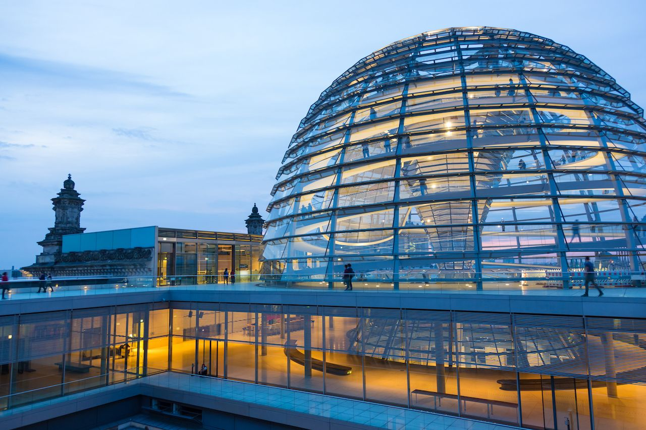 Illuminated glass dome on the roof of the Reichstag in Berlin in the late evening