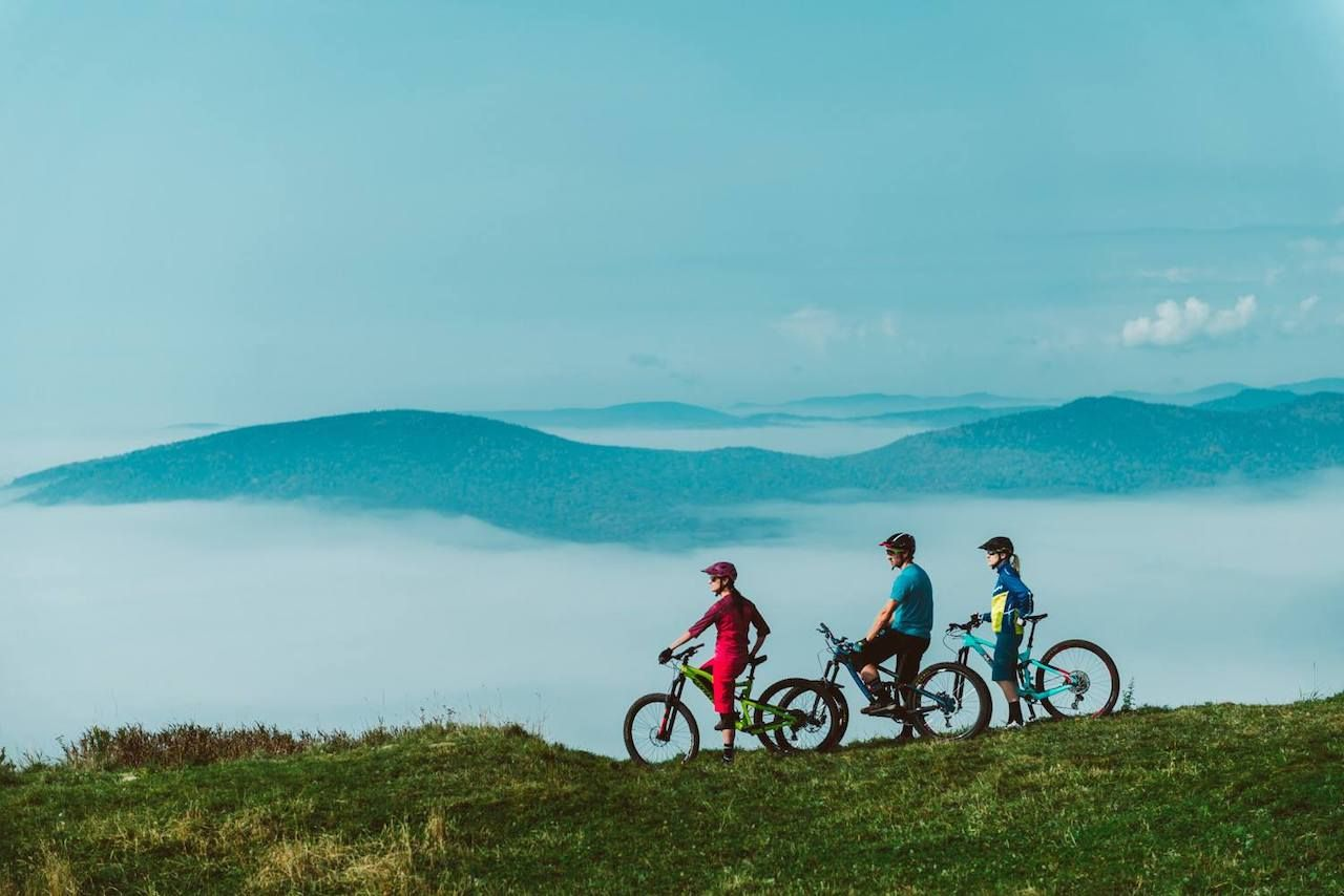Mountain bikers looking out over the fog