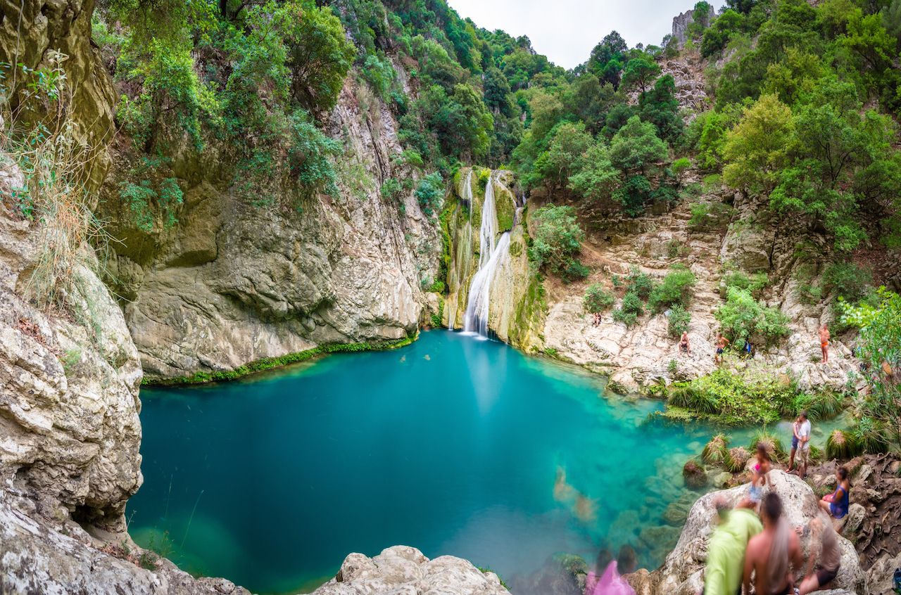 Natural waterfall and lake in Polilimnio area in Greece